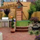 Small yard with entertainment area and kid friendly play area