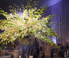 Fanciful, modern arrangements of dendrobium orchids punctuated the more traditional décor.