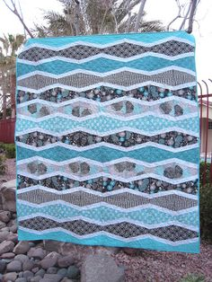Modern quilt pattern and fabrics, comes with a free pattern from: Made By Cola: New Wave Quilt