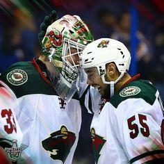 Minnesota Wild #40 Devan Dubnyk and #55 Matt Dumba celebrating a playoff win over the Blues