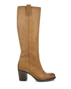 Endlessly versatile knee-high boots crafted from soft and supple Italian leather. Chunky stacked heel, and tabs at the top to pull on. A timeless and elegant wardrobe staple.