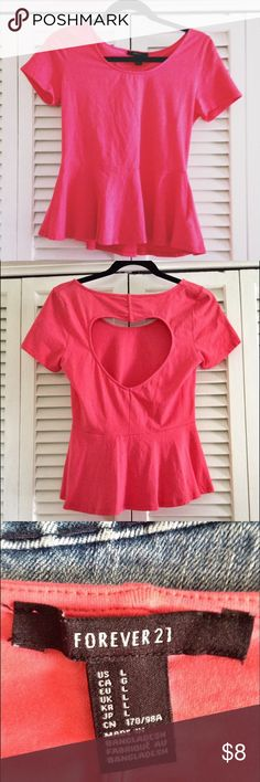 Cutout Heart Peplum F21 Shirt Super cute & girly peplum top! It's like a coral/pink color and has the sweetest cutout heart in the back. Like new! Size is a L but I can wear it and im a small in normal (F21 runs small) clothes. You do NOT want to let this cute top get away Forever 21 Tops Tees - Short Sleeve