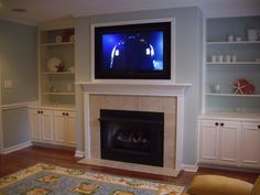 In this tv over fireplace design the tv is framed with white trim. Description from fireplacepictures.org. I searched for this on bing.com/images
