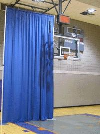 An Adjustable Height Backdrop masking off parts of a gymnasium.
