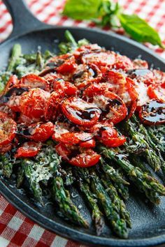 Balsamic Parmesan Roasted Asparagus and Tomatoes/I am not a vegetarian but I could just have this for dinner. Delicious. I will make again.