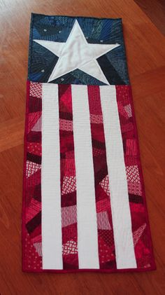 Patriotic Door Quilt ~ love this and I love the red 'crazy strip' with the white strip idea.  Nice contrast and it brings out the blue and the star.  I like this!