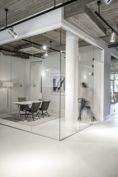 Small meeting room, great for short meeting. Using glass is great for not having people coming in, because you can see is occupied.: