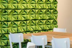 12 Ideas For Creating An Accent Wall Using Unexpected Materials // FELT -- Intricately folded pieces of green felt attached to this wall give it dimension, texture, and brighten up the room.