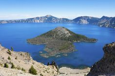 OREGON | CRATER LAKE NATIONAL PARK.  Created by the eruption and collapse of Mt. Mazama almost 7,000 years ago, the 6-mile-wide caldera offers a breathtaking 20-mile circle of cliffs offset by a lake of stunning blue water.