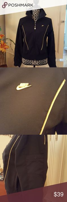 Nike Zip Front Jacket Size Medium 8-10 A dressier Nike zip front jacket with gold satin piping detail front and back. Metal Nike emblem. Small snap pocket on left sleeve. Collar can be turned back to black satin lining. 2 zip front pockets. Elastic waist. Last picture shows the weave detail of the fabric. 96% Polyester, 4% Spandex. Smone-free home. Great condition. Nike Jackets & Coats