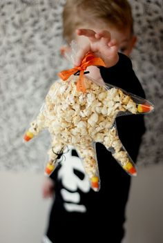 Monster Hand -- plastic glove, popcorn, candy corn, spider ring and ribbon.