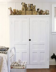Lift a rather dull room with innovative decorating.  Love the vintage dog collection.