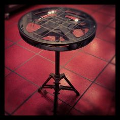 Pier 1 Movie Reel Accent Table... Looks like a pretty simple DIY project for the living room/theatre