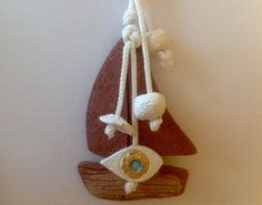 Evil Eye good luck charm wall hanging yacht by hippiefishbeachart