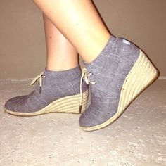 """Toms grey wedge booties! Grey canvas fabric with rope like wedge and laces. 3"""" heel. Good condition. Worn twice. Super cute!! TOMS Shoes Ankle Boots & Booties"""