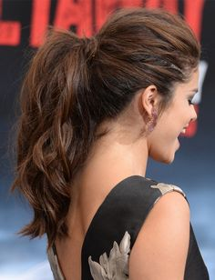 Selena Gomez's ponytail at the Getaway Los Angeles premiere had the perfect amount of texture and lift at the crown, making it red carpet appropriate, without going too far into bedhead territory. To get her wavy look, tease hair at the crown, curl with an iron and spray with dry shampoo before gathering hair into a ponytail.