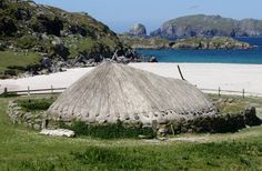 Bosta Iron Age House - Isle of Lewis, Outer Hebrides, Scotland;  a network of 9 stone buildings all connected by tunnels lay hidden under the beach until exposed by a storm surge in 1993;  thought to be a Norse settlement that dates to the 7th or 8th century;  double-walled stone houses were built into the sand, and the thatch (or turf) roof protruded above the dune;  about 20 feet in diameter with two rooms;  a replica was built for people to visit