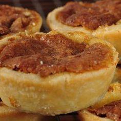 Sprinkle raisins over bottom of each tart shell.