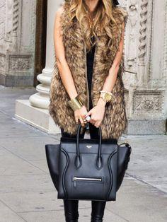 fur vest, celine bag, leather pants.