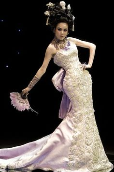 A model show off the latest from Chinese designer Guo Pei during the China Fashion Week in Beijing.