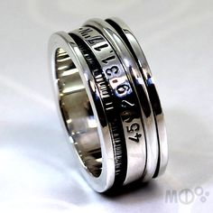 Spinner ring with longitude and latitude engraved in by MCDecarie, $140.00