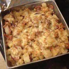 Okay. I can't take credit for these. My mom did most of the work! :) I just did the cheese! These are my moms crockpot ham and potato casserole! This is the best most amazing crockpot recipe there is out there! :)