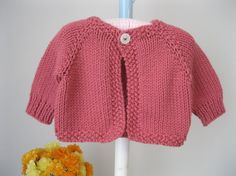 Hand knit baby sweater ...........rosy pink cardigan with 'flower' button
