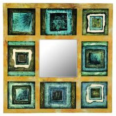 Wood-framed wall mirror with a turquoise, sage, and blue geometric motif.