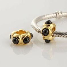 "18k Gold on 925 Sterling Silver European Style ""Onyx Cabochon"" Charm Beads for Pandora, Biagi, Chamilia, Troll and More Bracelets general gifts. $18.99. Hole Size: 4.5mm. Quantity: 1pc. Color: Silver with 18K gold. Suitable for 3mm Cable Pandora and other European Charm Bracelets. 18K gold plated 925 Sterling Silver"