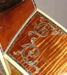 Detail on heavily inlaid 2006 Martin D-50 Koa Deluxe acoustic guitar.