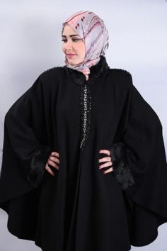 This winter cape with its fur around the collar and sleeves is a must-have in winter.   #islamicfashion #hijab #hijabstyle #hijabfashion #fashionista #hijabista