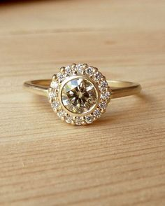 Yellow Gold Bezel Set Diamond Halo Ring