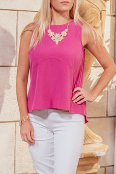 A bright blouse is a must-have for summer! To dress it up, pair with a statement necklace. The color options are endless!