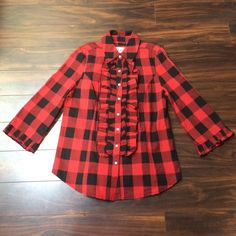 """Black and red plaid button down NWOT. 100% cotton. Ruffles on the sleeves and chest, white accent buttons (non missing), length 27"""" some stretch Live a Little  Tops Button Down Shirts"""