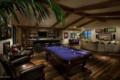 A man cave for Rob. Would include plasma, jukebox, pool table, poker table, computer consoles (old school aswel as modern) a bar, arcade games.