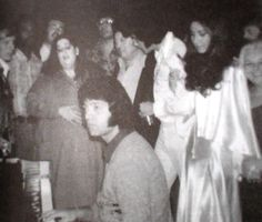 """February 23, 1973 In this photo - Joe Moscheo of the Imperials quartet is at the piano in Elvis' Hilton suite after a Las Vegas performance while Mama Cass joins in singing gospel with Elvis - Joe said one song they sang was """"Amazing Grace"""" (in the key of E-flat)  - Joe says Elvis was so proud to share the sound from his back-up group and their special relationship....he says, that half way through the song, Cass just stopped and listened."""