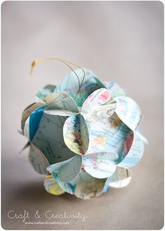 3D paper ball ornaments - in Swedish (I think?) and English. So pretty with recycled maps, old books pages, pretty craft paper, etc.