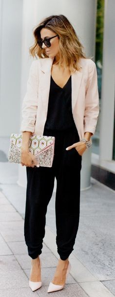 Christine Andrew is wearing a black jumpsuit from Revolve Clothing, pink blazer from Forever 21, clutch from Nila Anthony and pink shoes