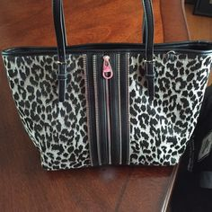 """Nine West Leopard Print Tote Black And Grey and some taupe Cheetah Print Tote made by Nine West in Great condition Carried it only a couple of times. 3 separate sections inside. Fake zipper front just or show. 15"""" wide 11"""" tall approx Nine West Bags Totes"""