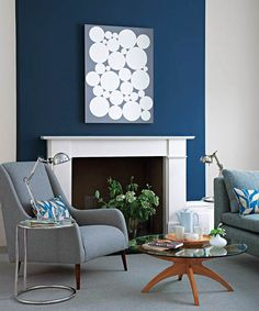 Color is one of the best ways to create a focal point in a space, and that's what an accent wall is. An accent wall can also play up a natural focal point like a stairway or a fireplace. To simplify color choice, she suggests using a darker shade of the same color as the surrounding walls, or at least a related color, such as the blue-gray combination in this room. | Photo: Mark Scott/Ideal Home/IPC+ Syndication