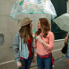 Pitch Perfect stars Brittany Snow and Anna Kendrick make the best of a rainy afternoon, bonding under our Bubble Umbrella in Flower Shower.