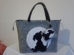 the Black Dog Cat, una serie di borse e pochette per gli amanti degli animali, in particolare dei cani, i migliori amici dell'uomo.