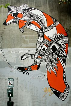 Trek's first mural for Living Walls. Tint of colors and divided shapes create a complete figure of a fox.