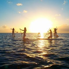 A sunset stand up paddleboarding