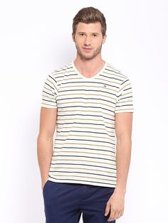 PRODUCT DETAILS  Off-white, mustard yellow and navy blue, striped, knit T-shirt, has a ribbed, rounded V neck, short sleeves, embroidered branding on the left side of the chest  MATERIAL & CARE  100% cottonMachine wash cold  SIZE & FIT  Slim fitThe model (height 6' and shoulders 18) is wearing a size M  STYLE NOTE  Go for the ultimate summer look with this stylish T-shirt from Mast & Harbour. Team it with shorts and flip-flops for a casual look.