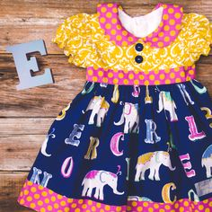 E is For Elephant is our first fall 2015 collection! Go back to school in style with this adorable dress. Collection releases July 22!