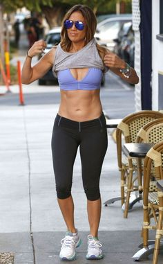 Damn, J.Lo! The singer shows off her hot body and six-pack abs after a workout.