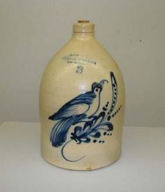 """THREE GALLON STONEWARE JUG. Stamped mark for """"New York Stoneware Co. Fort Edward New York"""". Blue slip decoration of a plump bird perched on a sprig"""