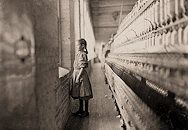 """One of the spinners in Whitnel Cotton Mill. She was 51 inches high. Has been in the mill one year. Sometimes works at night. Runs 4 sides - 48 cents a day. When asked how old she was, she hesitated, then said, """"I don't remember,"""" then added confidentially, """"I'm not old enough to work, but do just the same."""""""