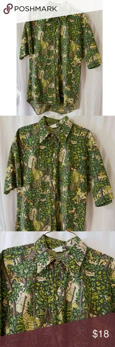 "Bushlan Mens Camoflauge Short Sleeve Shirt Made by Bushlan Size Small 60% Polyester, 40% Cotton Button front Chest Pocket Machine wash and dry  Measurements are approximate:      Length 28"" in front and 31"" in the back     Chest 44"" Bushlan Shirts Casual Button Down Shirts"